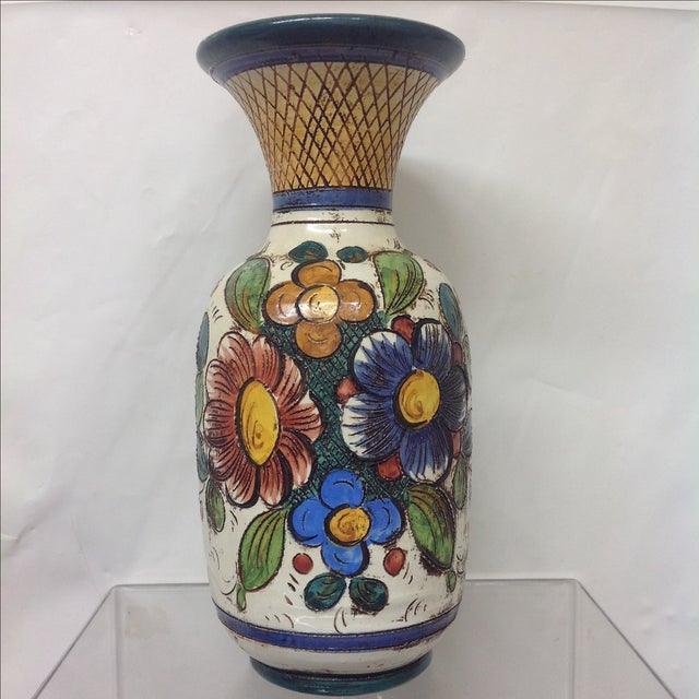 Large Mid Century Italian Hand Decorated Vase. Incised floral decor in blue, orange, yellow, mauve, and green.