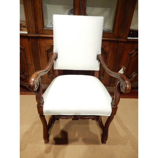Very nice late 19th c walnut Italian armchair. Very graceful carving and elegant lines. New linen upholstery.