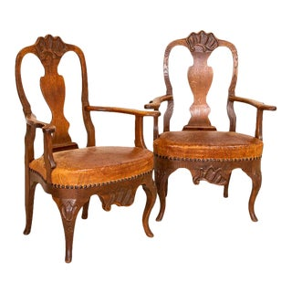Antique Pair of Carved Arm Chairs With Vintage Leather Seats For Sale