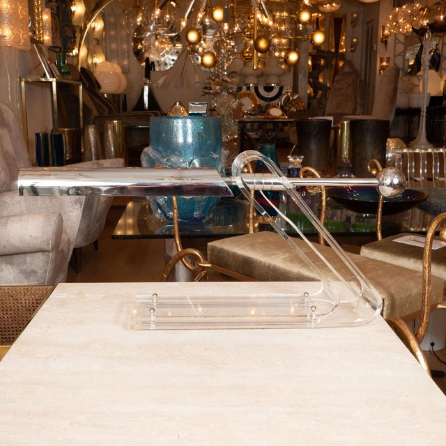 Unusual cantilevered Lucite and chrome desk lamp.