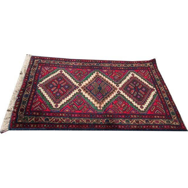Vintage hand-knotted Hamadan Rug. This piece has magnificent detailing and would be the perfect addition to your home....