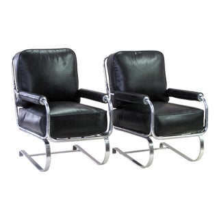 A stylish and rare pair of American 1930's machine-age tubular chrome springer arm chairs by KEM Weber for Lloyd Manufacturing
