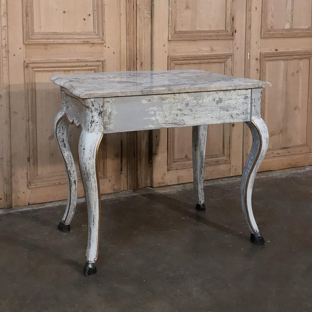 19th Century Swedish Painted Marble Top Console is a study in rustic charm melded with hand-crafted traditional methods...