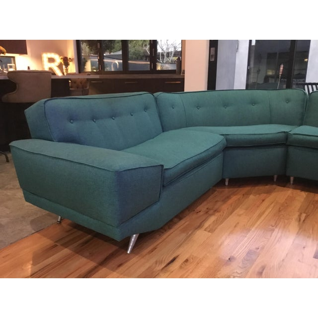 This is an original 1950's sectional sofa. It's in amazing shape, was re upholstered a year ago. Has a small flat welt...