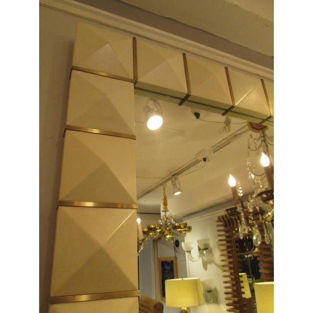 Custom geometric parchment mirror with inlaid brass.