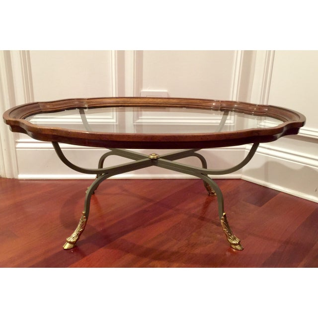 Unique vintage coffee table by Drexel Heritage. The beauty features a wood frame that sets on a metal base and brass claw-...