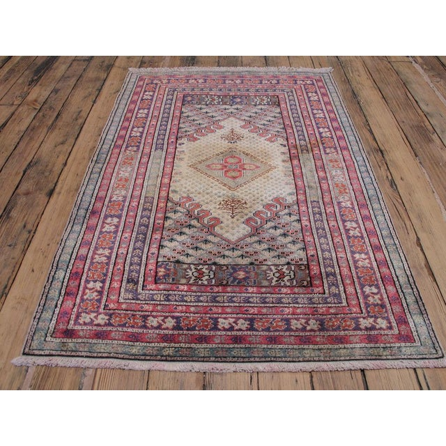 Vintage Turkish rug featuring an elegant 18th century design. The rug was woven with mercerized cotton, which was used to...