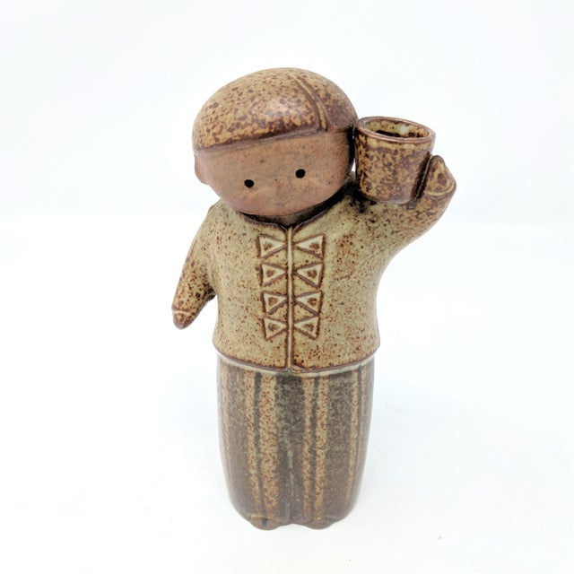 1960s Japanese Modern salt shaker and candle holder by Uctcti. Depicts a boy carrying a basket on his shoulder. In...