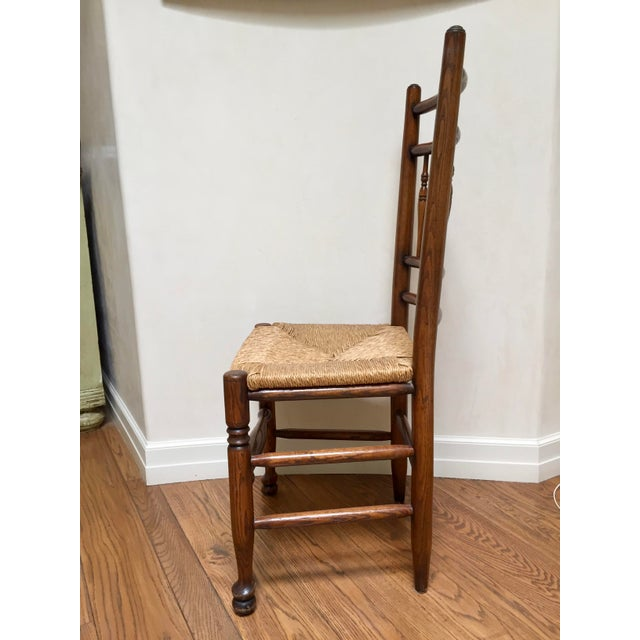 Antique, English country side chair with elm rush seat (removable) and spindle back. The sit is very upright. Seat width...