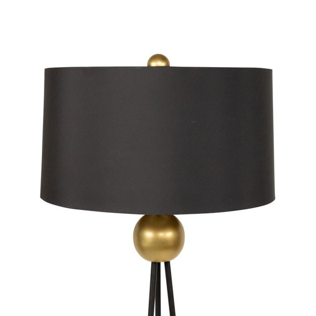 Pair of Contemporary black and gold metal floor lamps with sphere decoration, gilt circular bases, and black metal drum...