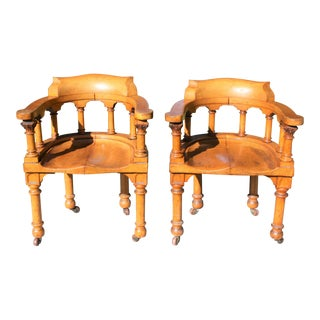Pair of Arts and Crafts Tub Chairs / Barrel Back Chairs With Shaped Solid Seats & Rollers For Sale