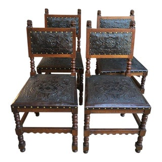 Set of 4 Antique French Renaissance Carved Oak and Embossed Leather Dining Chairs For Sale