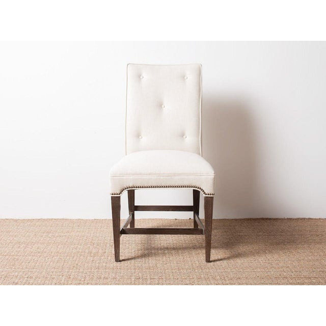 Upholstered side chair Exposed nail head features. Additional fabric/finish options available.
