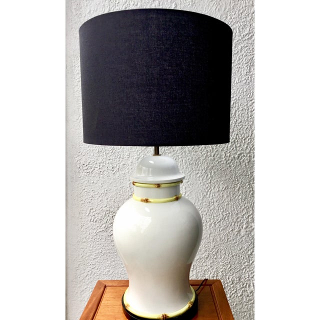 Large scale white porcelain lamp mounted on a wooden base. Bamboo motif on edges. Base is about 9 inches in diameter.