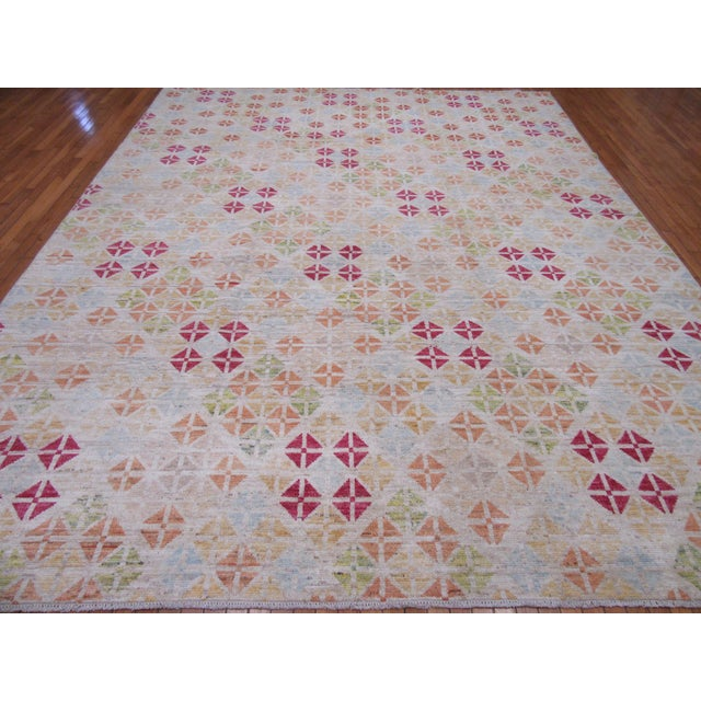 This is a new hand knotted wool rug from Afghanistan. It is made with wool colored with all natural dyes in a geometric...