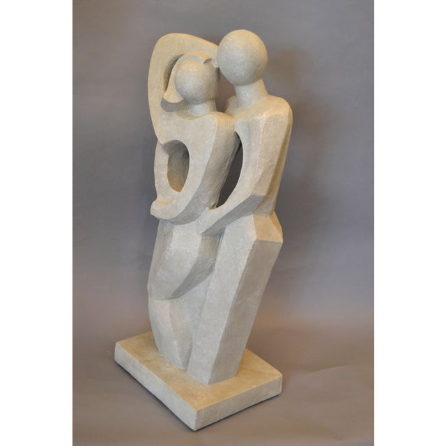 Modern Abstract Geometric stylized Embracing Loving Couple Sculpture, Figurine, Statue in Gray Plaster. The bottom is...