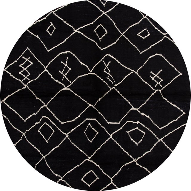 Beautiful Moroccan-style rug, hand-knotted wool with a black field, white accents in a gorgeous all-over tribal design....