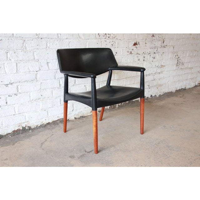 Black leather and Brazilian rosewood armchair by Ejner Larsen and Akesel Bender Madsen. The chair was constructed by Willy...