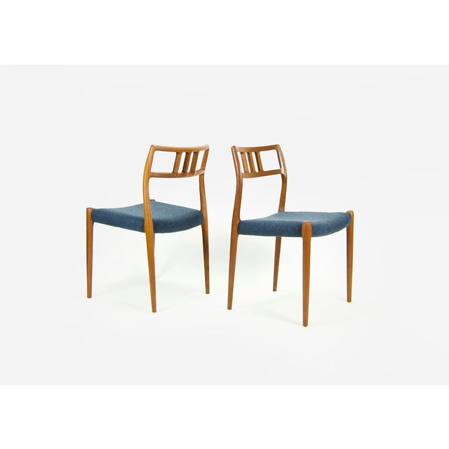 1960s Set of four dining chairs Model 79 designed by Niels Otto Møller for J.L. Møller. The chairs feature a solid teak...