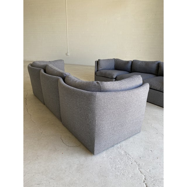 Fantastic newly reupholstered modular sectional in a textured gray tweed fabric designed by Milo Baughman. Six pieces with...