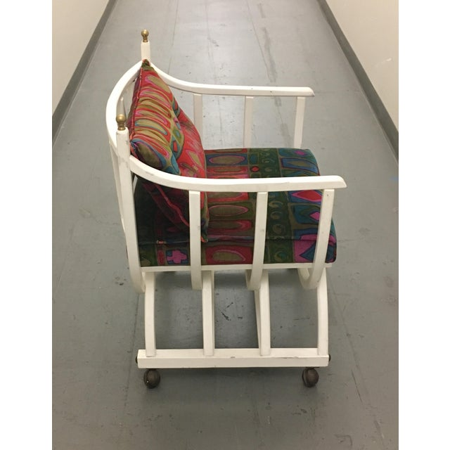 This unusual shaped white painted wood arm chair upholstered in velvet Jack Lenor Larsen fabric comes to you in its...
