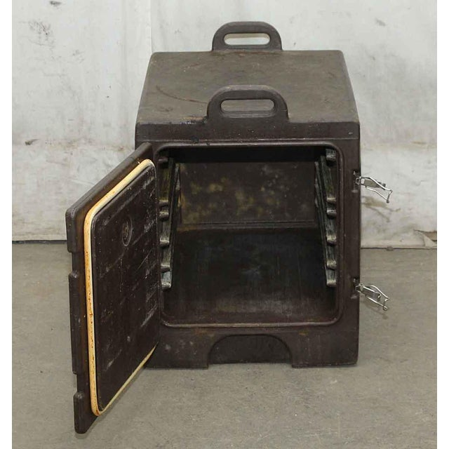 Preowned black food pan carrier. Made by Cambro Manufacturing Co. Priced each.