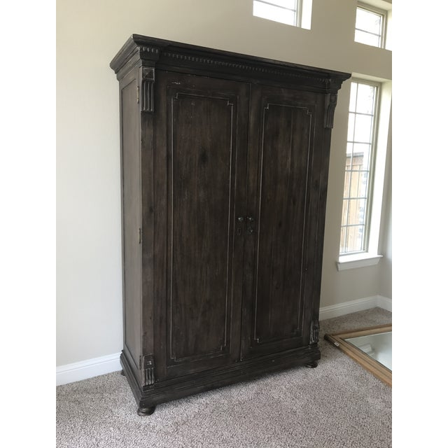 "Hardwood, antiques coffee finish armoire. Bought from Restoration Hardware about 2 years ago. Overall: 56""W x 25""D x 84""H..."