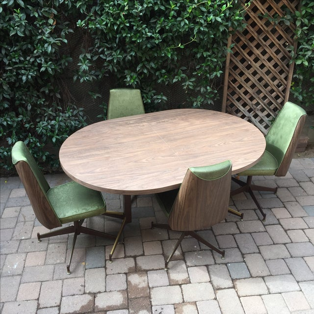 Super stylish retro dining set in good vintage condition. 4 green vinyl and faux wood upholstered chairs on Herman Miller...