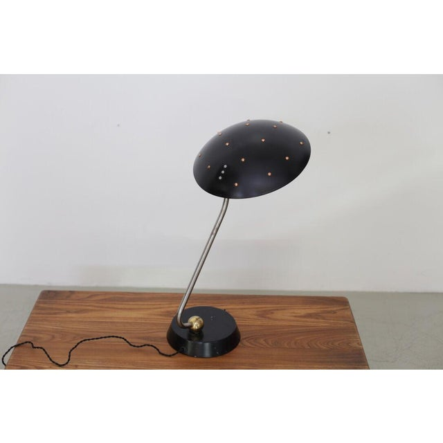 Huge black table lamp with unique chrome, copper and brass details from the 1950s. Good vintage condition! Wiring is in...