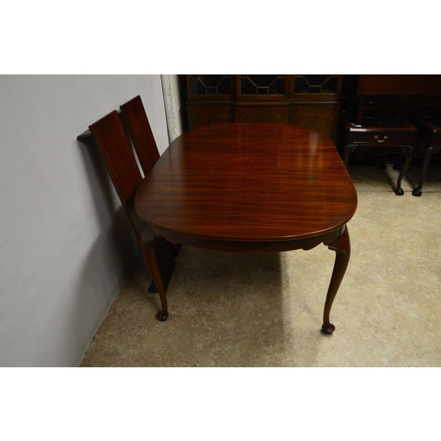 The table is sturdy,has small chips as pictured. Some scratches. Marks to the top, most of which are noticeable at a...