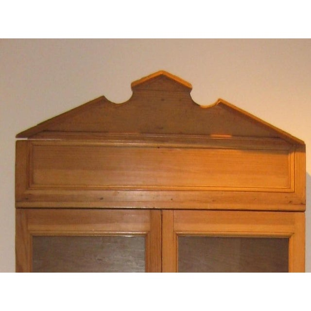 A pine and Sabino wood vitrina from Puebla Mexico. Created at the end of the 1800's and was part of the niche in the wall...