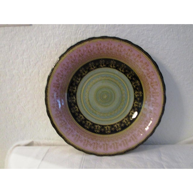 Stunning large ornate art glass bowl in shades of light pink, aqua, black and gold. Excellent condition.