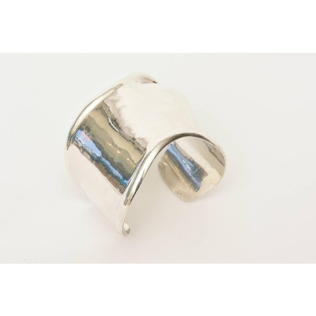 This lovely and original design cuff bracelet is signed Hecho en Mexico with the jewelry maker's mark. It is Los...
