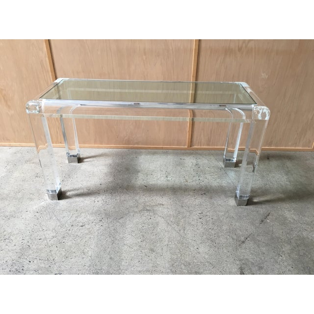 20th century Lucite console table with glass top and chrome feet in the style of Karl Springer.