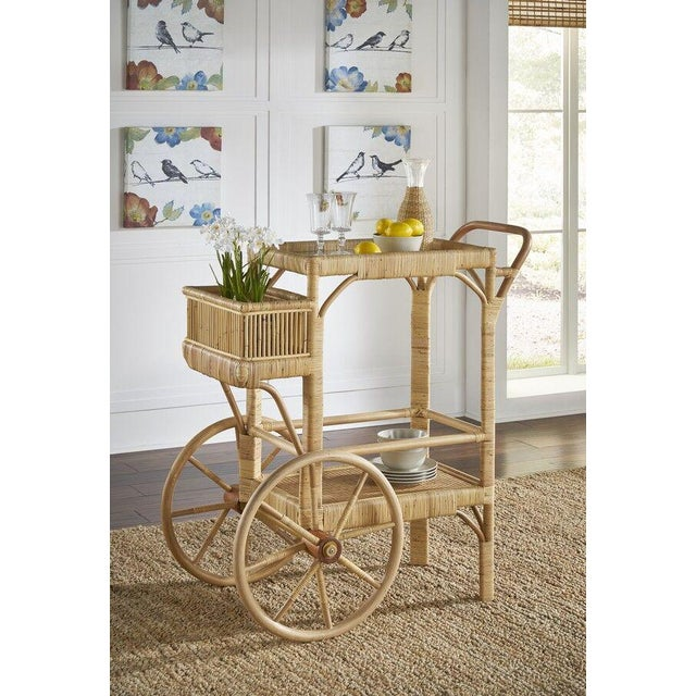 Bimini Bar Cart. Upper Tray has a Glass Surface with a Basket Front. Color - Natural.