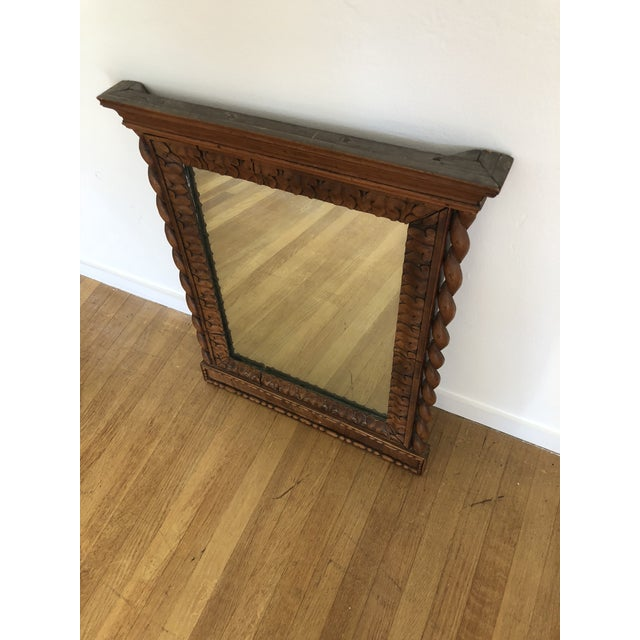 Beautiful hand carved wood mirror. Circa 1800's with square nail construction. The pictures speak for themselves as to...