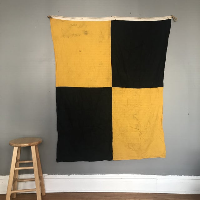 """Vintage black and yellow """"L Lima"""" nautical code flag. This flag is the international maritime signal for """"stop your vessel..."""