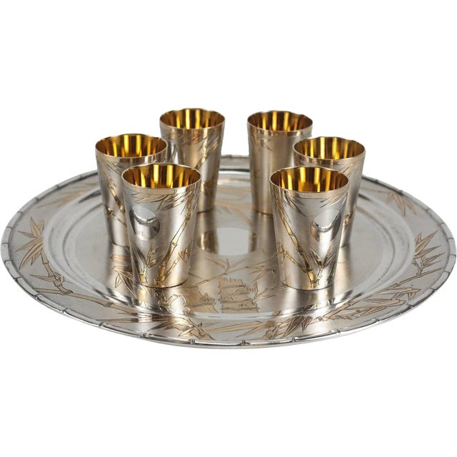 A Mid-Century decorative sake service from Japan consisting of a serving tray and six sake cups (shot glasses). The tray...
