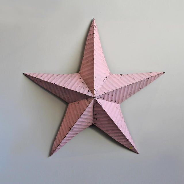 Large pink barn star made from recycled galvanized metal roofing with an aged painted patina. There are 6 available,...