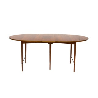 Paul McCobb Oval Walnut Dining Table With Brass Edges and 6 Leaves For Sale