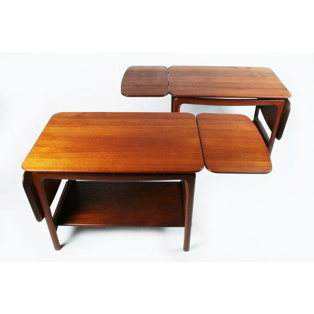 "A beautiful pair of teak side tables or occasional tables comprised of double drop leaf tabletops (54 1/2"" length with two..."