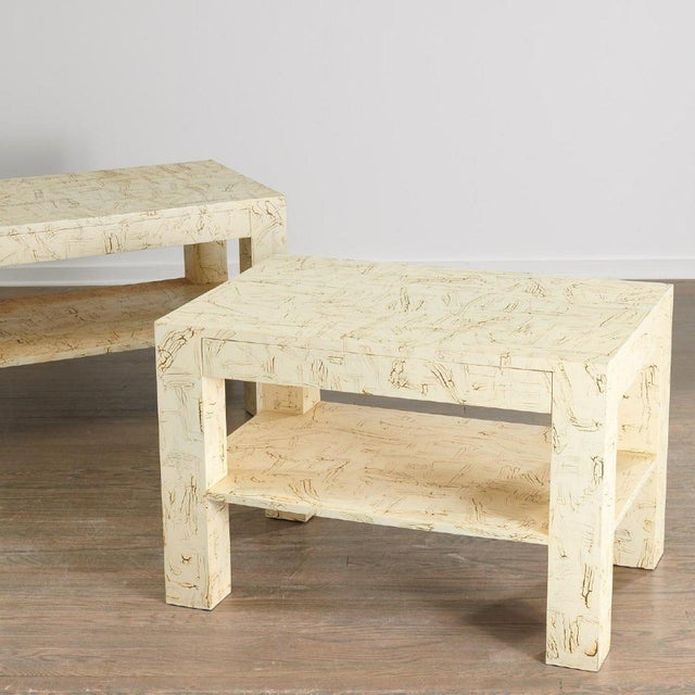 Pair Juan Pablo Molyneux Side Tables. Two-tiered tables with a faux craquelure lacquered finish over wood. These tables...