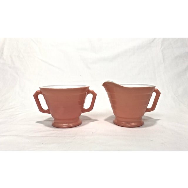Set of 1940s Salmon color sugar and creamer by Moderntone. Platonite glass. Although it is sometimes referenced as milk...