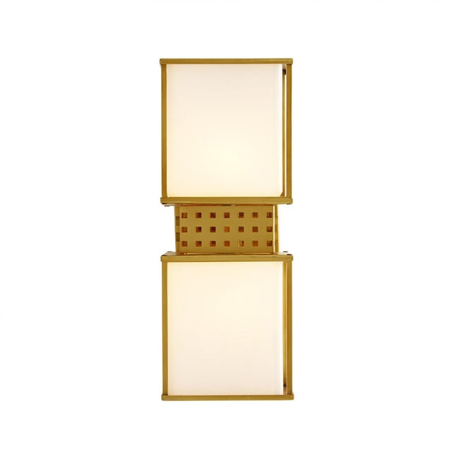 So simple and so modern this is a sconce that fits in anywhere. Clean lines crafted from stainless steel frame cubes of...