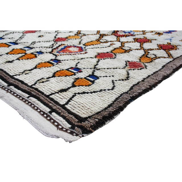 Vintage Moroccan rug hand-knotted with Intricate Berber motifs in a low-cut organic wool pile.