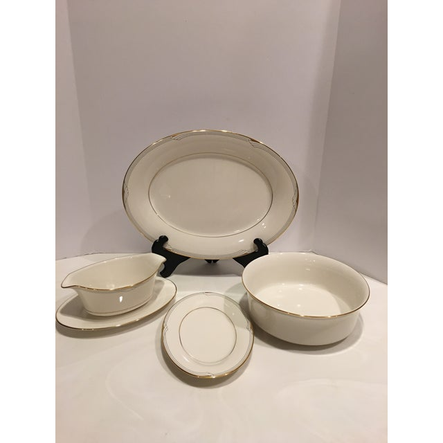 Golden Cove by Noritake, new traditions silver/white with gold border Geometric china. You will receive 12 - 5 piece...