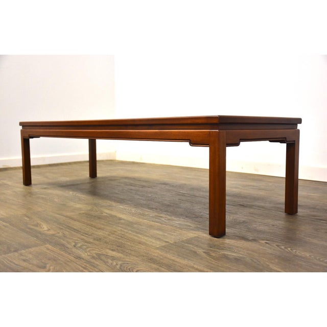 "A mid century modern walnut coffee table. Two minor marks. Excellent overall condition. 60.25"" wide. 20"" deep. 15"" tall."