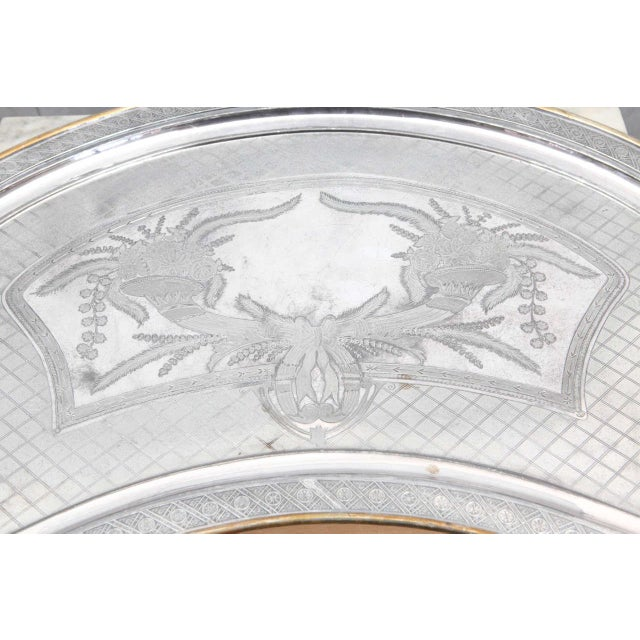 """This tray is termed a """"butler tray"""" because it is shaped to fit against the body with two handles. The silver plated tray..."""
