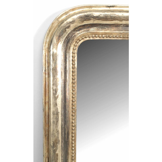 French Victorian style (19/20th Cent) silver gilt framed mirror with rounded top sides and burnished silver floral design...