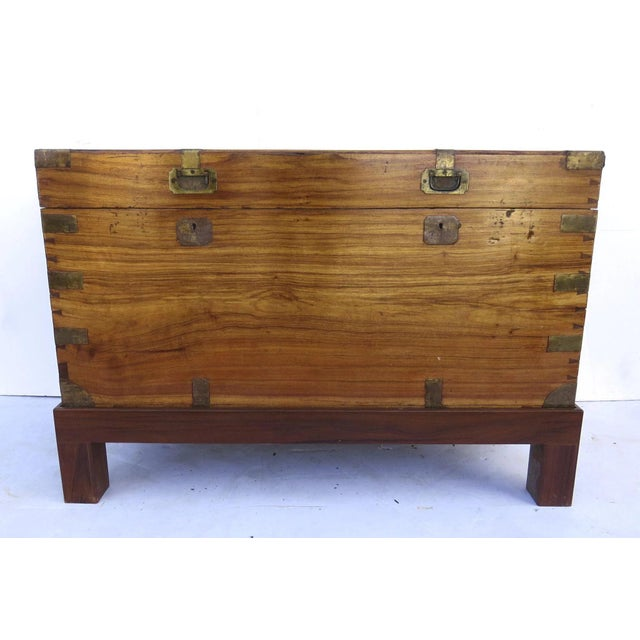 Early 19th century camphor wood Military campaign chest on stand. Protected brass corners, side carrying handles, and...